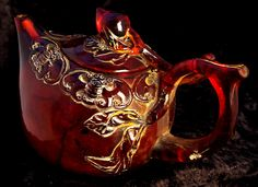 Baltic Cherry Amber Teapot $220 Carved from a single block of amber. Excellent craftsmanship. 10 1/2 x 16 x 9 1/2 cm. 333g $220.00 (nzd)