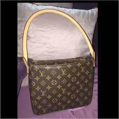 20% OFF‼️Authentic Louis Vuitton shoulder bag ‼️Like new condition‼️Spacious interior. Louis Vuitton Looping MM bag. One inside zippered pocket. One cell phone pocket. Size in inches (approx.): W 9.45 x H 8.25 x D 4. Handle drop in inches: 9.45. Suede leather interior in great condition. A tiny little stain inside (see pic) which is hardly noticeable, no rips, no loose threads. Excellent quality! Made in France. See my other listing for more pictures. Louis Vuitton Bags Shoulder Bags