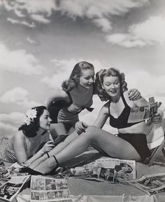 Vintage photo Women on the beach reading newspapers