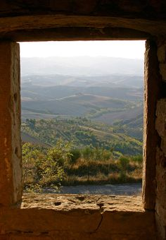 """View west across the Tuscan plain from a ruined monastery at the edge of the cliffs (""""balze"""") in Volterra, Italy."""