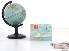 Wallet made of vintage map  A wallet made of original vintage atlases - not just for your vacation fund.  The atlas paper is decorated with an airplane and a vintage stamp. To protect the...