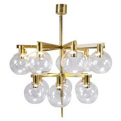 1stdibs   Very Elegant Brass & Glass 15-Light Hans-Agne Jakobsson Chandelier via Joakim Von Ditmar.