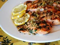 Mediterranean-Style Grilled Salmon  ~  Dietitian's tip:  Instead of the usual breaded and fried fish, this fish is grilled, Mediterranean style. You may substitute swordfish, halibut, sea bass or any other whitefish, and the calorie values are similar.