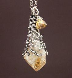 Citrine point and trillium cut citrine gem necklace.