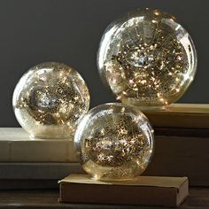 Bring your home to life with this set of 3 Pre-Lit Gold Mercury Glass Globes. The warm white lights make the gold mercury glass finish sparkle from the inside! Compare to Pottery Barn version which re