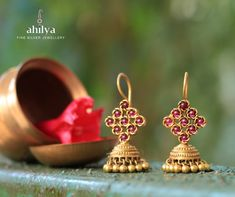 Crafted with precision, these gold plated jhumkis with ruby coloured stones laid out in a striking rhombus pattern and little ghungroos - add grace to your look. Pure Gold plating done on Sterling Silver. Gold Jhumka Earrings, Indian Jewelry Earrings, Jewelry Design Earrings, Gold Earrings Designs, Fancy Jewellery, Antique Earrings, Gold Jewelry Simple, Silver Jewelry, Silver Ring