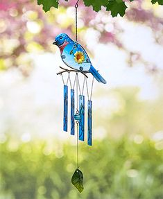 Add a beautiful accent to your home with this Colorful Glass Bird Wind Chime. It features a vibrantly colored metal bird with a glass body. The bird is perched Metal Birds, Glass Birds, Solar Kids, Glass Wind Chimes, Garden Decor Items, Bird Theme, Animal Silhouette, Bird Design, Tree Branches