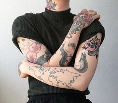 Love the top, the tattoos and the tucked in look. Absolutely incredible.