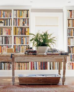 If you have enough books to warrant your own card-catalog system, turn an entire wall into a mini library. Leave the rest of the room neutral so that the wall of books provide the only vivid color.