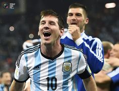 World Cup 2014: The Netherlands vs Argentina Semi-Final Highlights - Argentina's Messi celebrates with teammate Andujar their win over the Netherlands at the end of their 2014 World Cup semi-finals at the Corinthians arena in Sao Paulo . DYLAN MARTINEZ/REUTERS