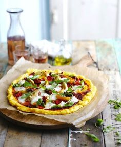 Polenta Pizza on wooden serving tray,rustic tabletop Hands-on time 15min…