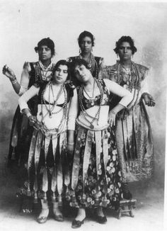 Massin sisters, Luxor, Egypt. note rolled belts w/ hanging strips of embroidered/brocade (?) fabric or ribbon.