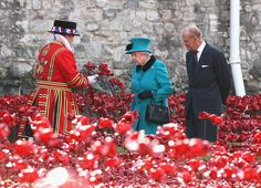 Queen Elizabeth II and Prince Philip, Duke of Edinburgh visit the Blood Swept Lands and Seas of Red evolving art installation at the Tower of London on October 16, 2014