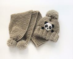 Matching set of knit pom pom beanie and scarf for kids.  Hat is knitted seamlessly in the round with pom pom on top and cute crochet panda bear applique hand sewn onto. Measurements: Hat- 19-21 (48-54cm )-child size Scarf is 50 (127cm) long and 7 (18cm) wide  Materials- merino wool.  Color- Light brown *Real color may slightly differ due to computer monitor projections and photo lighting. This hat and scarf set is READY TO SHIP! Please read my SHOPS POLICIES about shipping here…