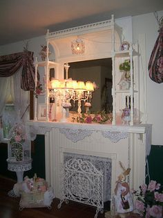 I LOVE the fireplace screen and the light on the mantle.  BEAUTIFUL room