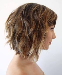 medium length choppy bob with caramel highlights