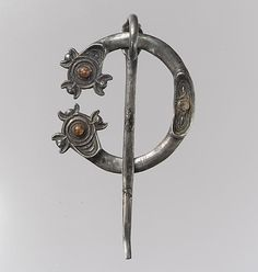 Open-Ring Brooch, early 9th century, make in Galway, Ireland, Pictish or Irish, cast silver, partially gilded, amber cabochons.