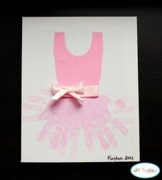 Craft that's cute for a playroom. #baby #infant #handprint #ballet #art #craft #pink #DIY #easy #simple #toddler #preschool #prek #kindergarten #home #playroom #bedroom #kids #child #children #daughter #girl #tutu #framedart #gift via Meet the Dubiens