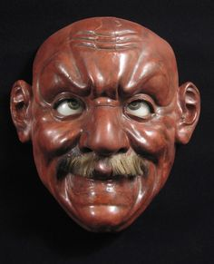 "Curiosities - Iki-ningyō (living doll), Japan. This large example of an iki-ningyō face measures 14.5"" high by 14"" wide. His moustache is intact, eyebrows are missing, and his features portray a Westerner – check the profile. Paper-maché, glass eyes. Meiji Period 1868-1912. Ex Frank Galeno, San Francisco. #8055  SOLD"
