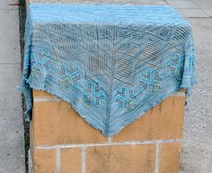 Anastasia is a reversible shawl with picot edging and beads that accentuate a lacy four-heart motif (inspired by an almost identical motif in Nancy Bush's Knitted Lace of Estonia).