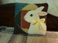 Antique quilt rabbit pillow