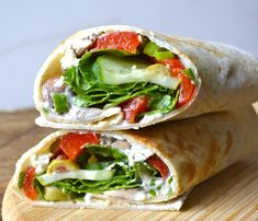 This Greek roasted red pepper wrap by Maebells' is made simply by rolling up roasted red pepper, spinach, cucumber, goat cheese, feta, olives and green onions together. This version of the recipe c...
