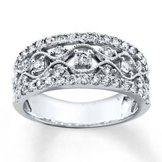 A criss-cross pattern of 14K white gold cradles diamonds to create this glamorous ring for her. A row of more diamonds flanks each side, bringing the total diamond weight to 1 carat. Diamond Total Carat Weight may range from .95 - 1.11 carats.