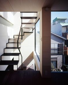 apollo architects & associates designs a spacious townhouse full of light on a narrow site overlooking tokyo skytree. Staircase Handrail, New Staircase, Loft Spaces, Living Spaces, Tokyo Skytree, Stairways, Architecture Design, House Design, Apollo
