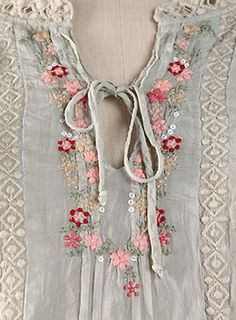 embroidered fine linen of pale blue. small pink and red flowers. Ana Rosa
