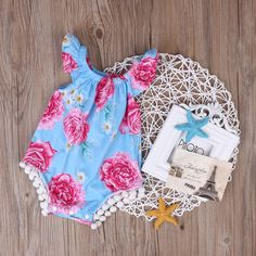 Blue+floral+vintage+romper+with+pom+pom+trim.the+current+wait+is+3+weeks-sizes+are:  sizes+are+: 0-6m,6-12m,+12-18m,18-24,+  these+rompers+are+made+to+stretch+but+if+worried+about+the+size+leave+your+childs+waist+measurement+<3