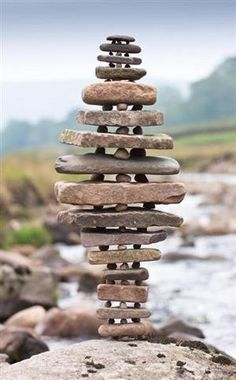 Balance- This picture shows balance as the stones are visually staying on top of each other. It is equal because the top and bottom start out as small and then gradually get bigger the closer it gets to the center. The background is blurry for the viewer to focus on the stones.
