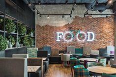 Ladrillo decorativo restaurante con efecto de lucido y bicicleta iluminada