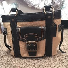 Authentic coach bag! Perfect for summer This is a coach straw purse!  It's perfect for the summer and is in great condition. Bought it straight from the coach store and a dust bag is included! There is a small spot on the side but an come out easily! OPEN FOR PRICE OFFERS Coach Bags