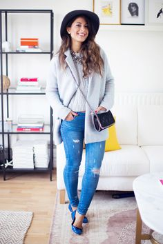Mimi Ikonn   Icy blue coat, cable stich sweater, ripped blue jeans, statement necklace, navy hat, blue flats, Stella McCartney bag