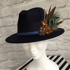 3c04ab8078d64 Navy fedora embellished with natural game bird feathers