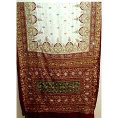 (Panetar) White -Maroon Gajji silk Panetar with hand embroidary all over the saree as shown in the picture. Very traditional and beautiful. Blouse piece is included.