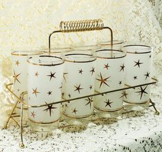 1950s complete set of atomic star high ball glasses with caddy