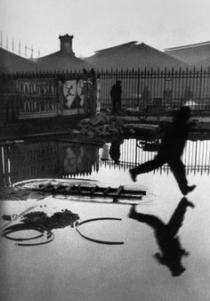 View Behind the Gare Saint-Lazare, Paris by Henri Cartier-Bresson on artnet. Browse more artworks Henri Cartier-Bresson from Feldschuh Gallery. History Of Photography, Candid Photography, Documentary Photography, Street Photography, Urban Photography, Photography Office, Photography Movies, Motion Photography, Photography Composition