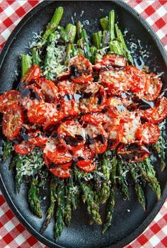 Roasted asparagus and tomatoes covered in melted parmesan and drizzled with a balsamic reduction.