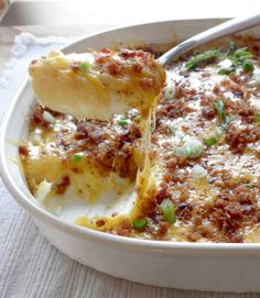 Baked Potatoes Casserole with Cream Cheese, Bacon, and Garlic.