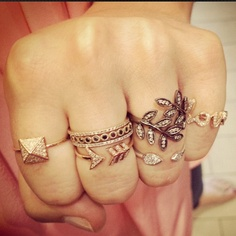 gold and pave diamond stack rings.
