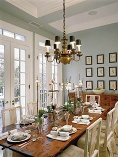 dining room  soft blue gray walls, brass chandelier, rustic farmhouse dining table, ...