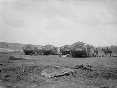 BATTLE SOMME 1 JULY - 18 NOVEMBER 1916 PHOTOGRAPHERS (Q 5576)   Four Mark I Tanks filling with petrol. Chimpanzee Valley, 15 September 1916. (Tanks first went into action on this day).