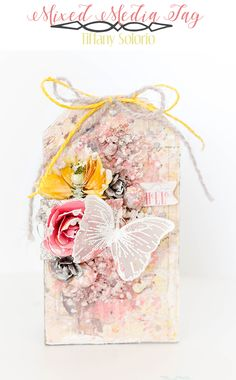 """""""I created a fun tag with lots of texture using a bunch of the Art Basics collection - White Gesso, Light Paste, Color Bloom Sprays, Stencils, Art Stones, and Art Pebbles. These colors were so fun to work with!"""" ~ Tiffany Solorio"""