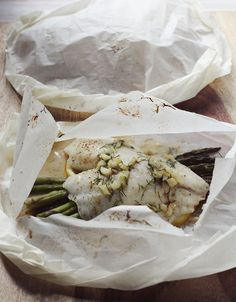 Parchment paper steamed fish -- Made this and it was insanely delicious. Perfect balance of lemon, butter, garlic and dill. I cooked 2 filets at a time, so 20 min in the oven did the trick. Will definitely make this again!