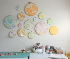 Using vintage sheets & embroidery hoops for wall decor.  Brilliant!  www.diaryofaquilter.com