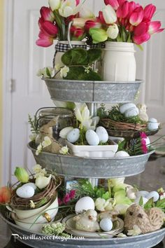 Take all your Easter decorations and create an eclectic centerpiece like this Spring Galvanized Centerpiece. More Spring & Easter Home Decor Ideas on Frugal Coupon Living.