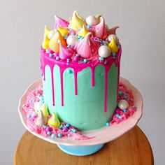 Layers of raspberry velvet cake & chocolate mudcake, filled with a raspberry, coconut & rose cream, covered in bubblegum flavoured Swiss meringue buttercream & topped with all things horrendously fun - @katherine_sabbath