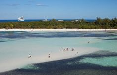 White sand beaches and azure-colored waters in #CocoCay.