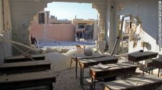 35 reported killed in airstrikes on Syrian school